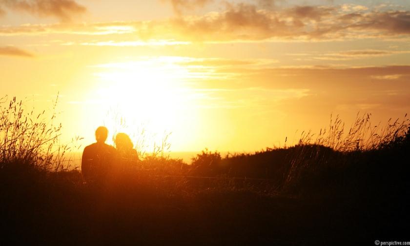 couple-in-sunset-7da5459f-9877-4d84-bc7b-1fd4451db8f9.jpg